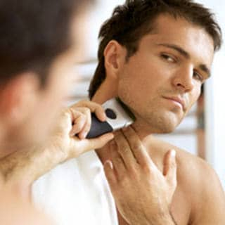 Man using electric razor